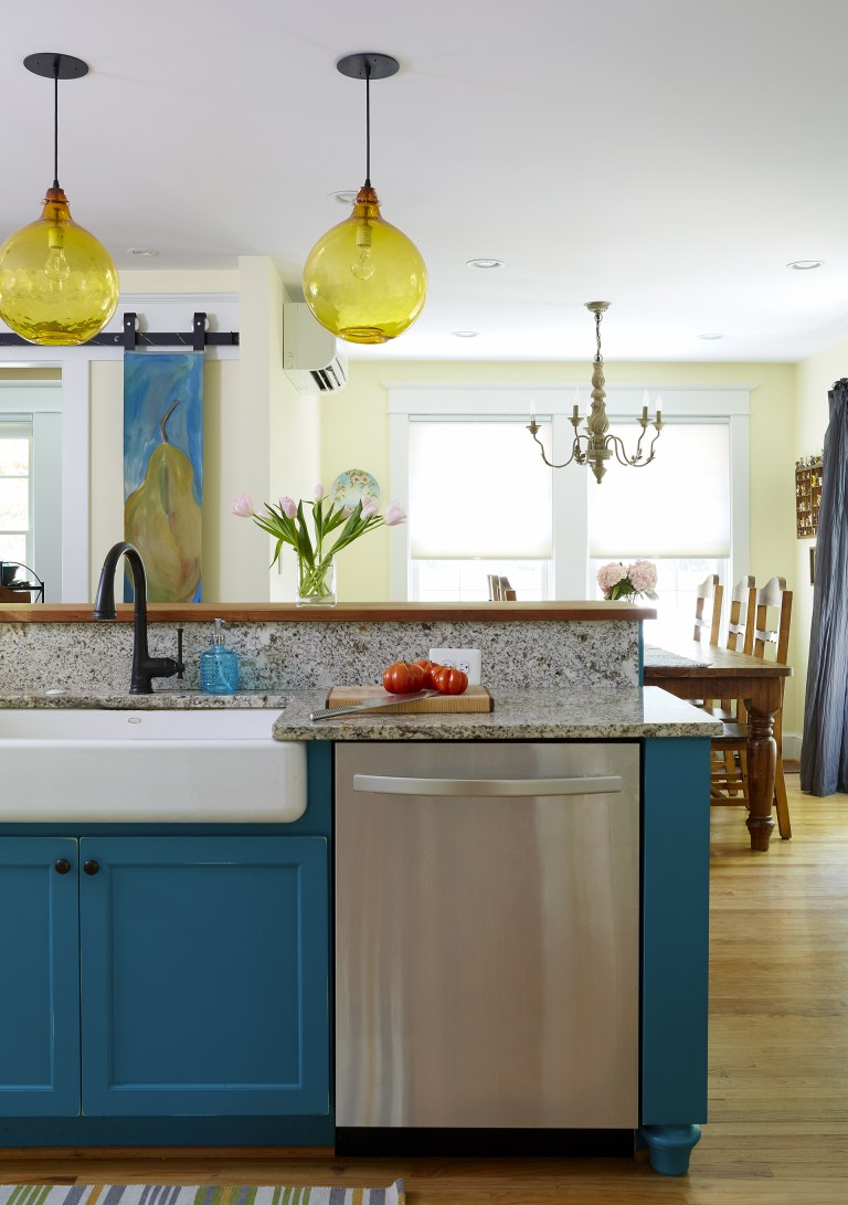 teal island in kitchen with stainless steel appliances
