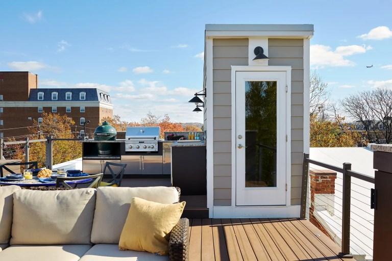 glass door leads to rooftop living area