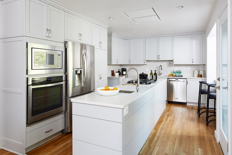 kitchen with white cabinetry and center island stainless steel appliances wall oven