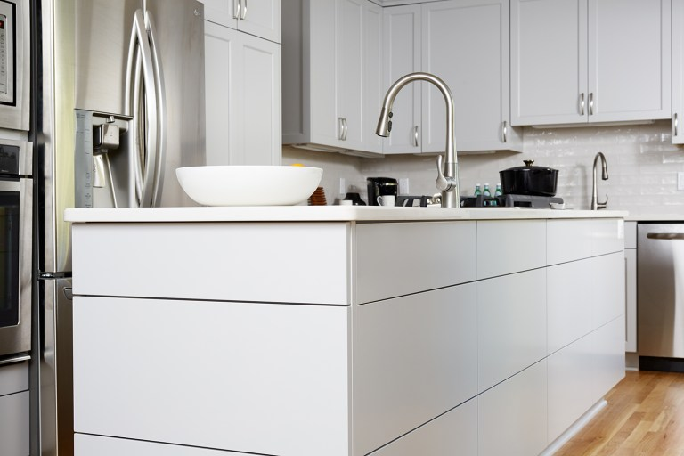 kitchen island with sink white cabinetry