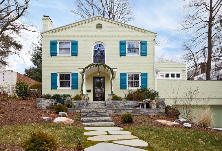 front porch renovation on DC home blue shutters stone walkway