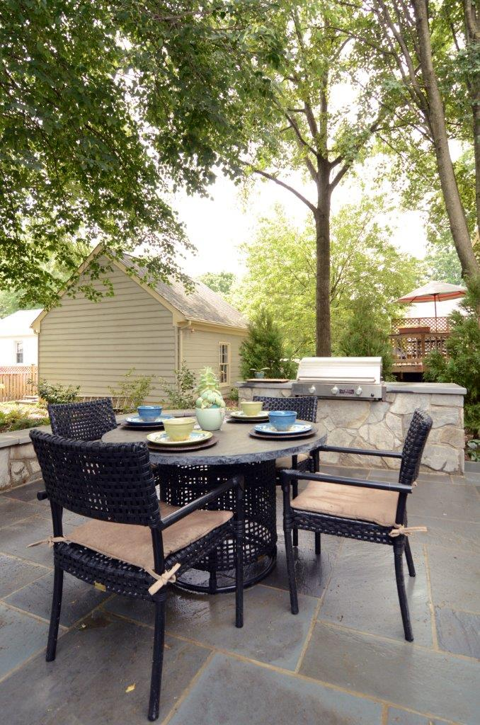 outdoor dining area and built in grill