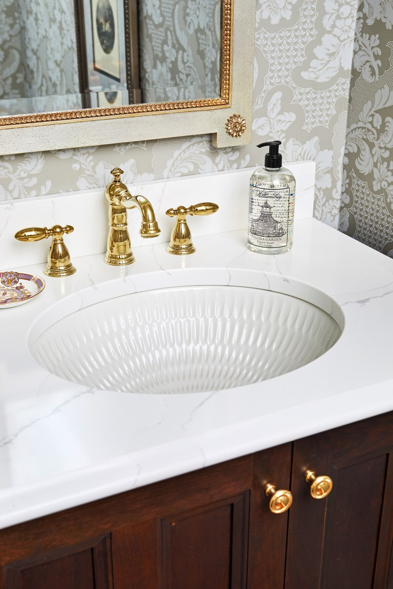 ceramic oval undermount bathroom sink with overflow with brushed gold two handle bathroom faucet