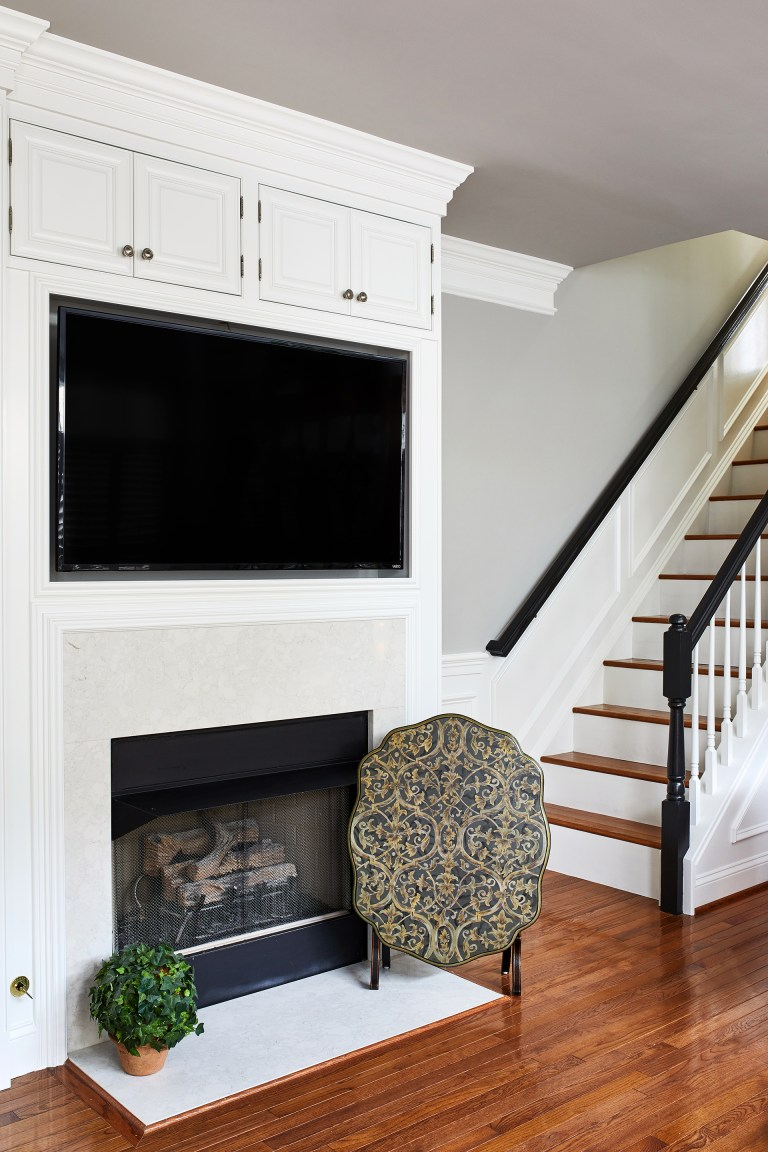 floating tv with cabinets above, electronic fireplace
