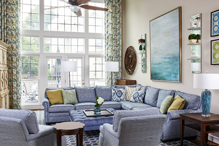 home remodel large living room with two story windows, ceiling fan with light and large area rug