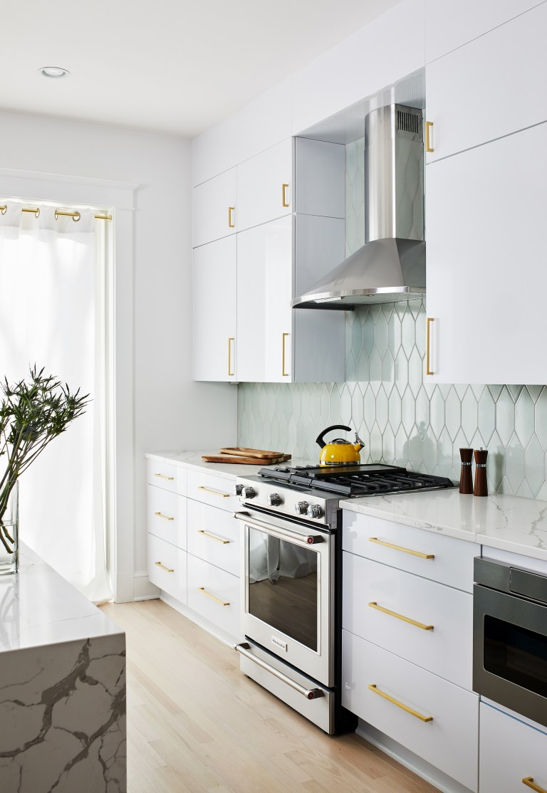 white cabinets with gold handlers