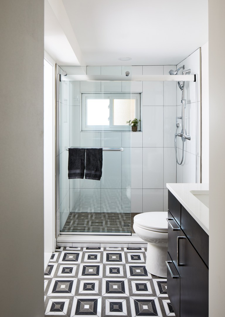 case design build bathroom with bypass glass sliding shower door in chrome