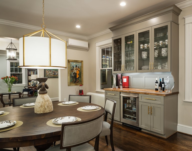 glass front cabinets with gold pendant light