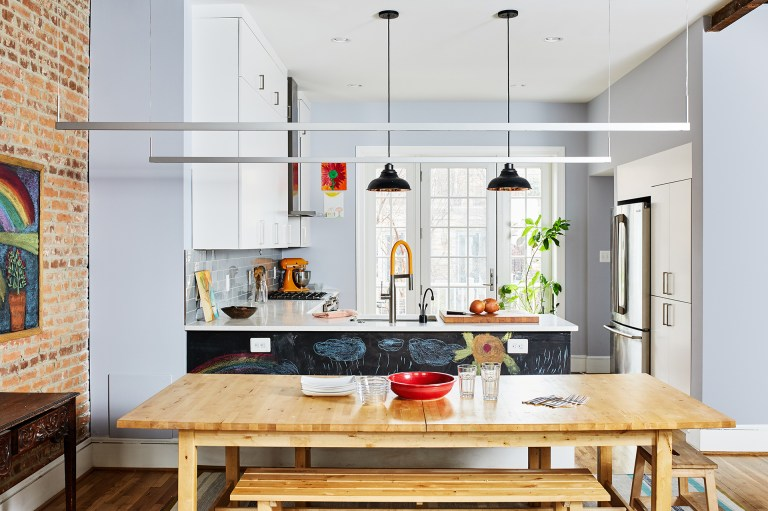 kitchen renovation in DC home bright and open to dining area exposed brick wall