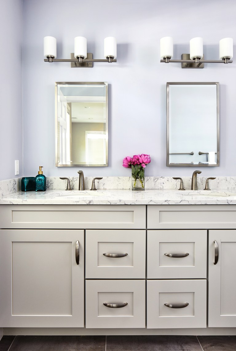 his/her double sink with double vanity with center drawer and cabinets