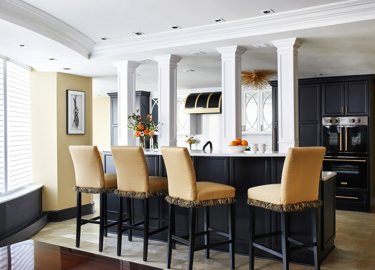 large traditional galley dark wood floor enclosed kitchen with a farmhouse sink, marble countertops, white backsplash