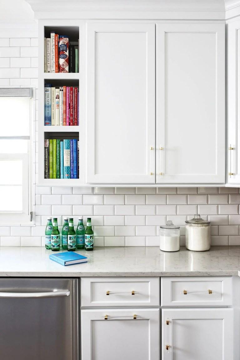 white cabinets with white subway back splash
