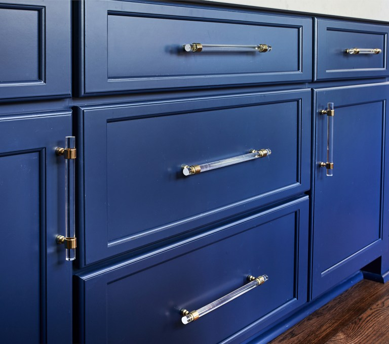 large blue wide drawers with traditional pull handles