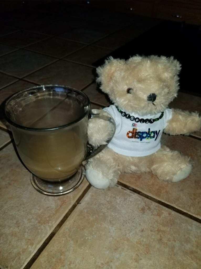 Display bear has a coffee addiction
