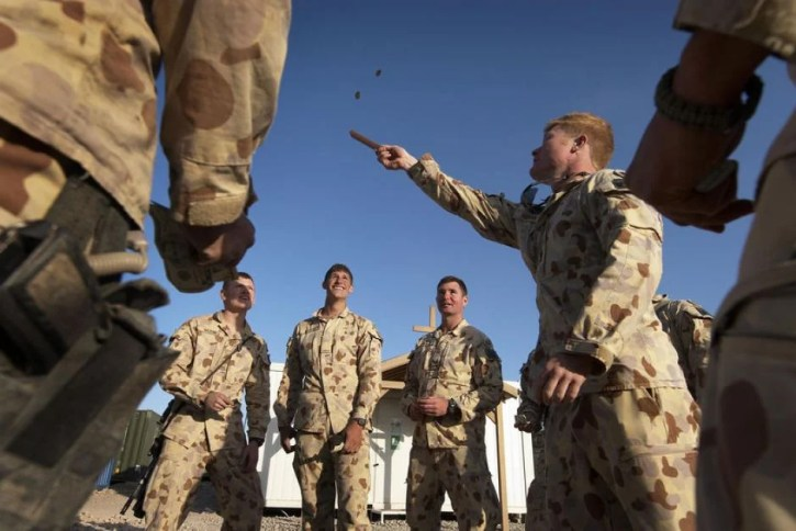 Soldiers playing a game of 2 Up