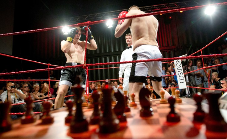 An action shot of a chess boxing exhibition