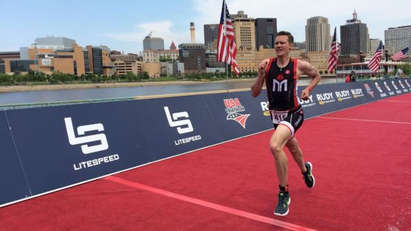 Athlete Chris Mosier at finishing line