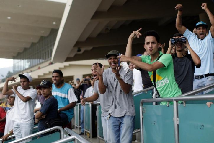Horse racing fans attending a race in Venezuela