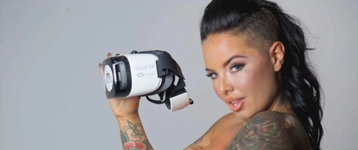 A photo of a stripper holding VR equipment
