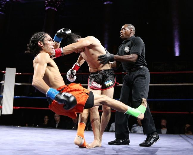 a muay thai referee with fighters