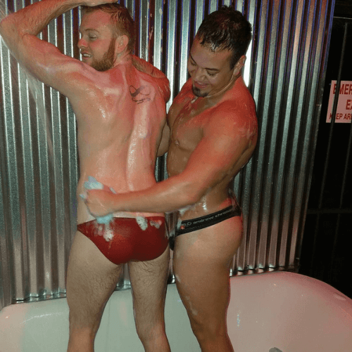 Two Studs and Suds guys performing in a bath