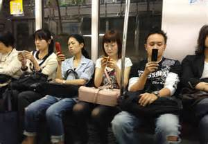 4 cell phone on subway