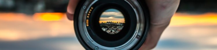 Cityscape shown through a camera lens