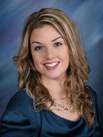 Jodi Goodrich, PA-C in a blue blouse