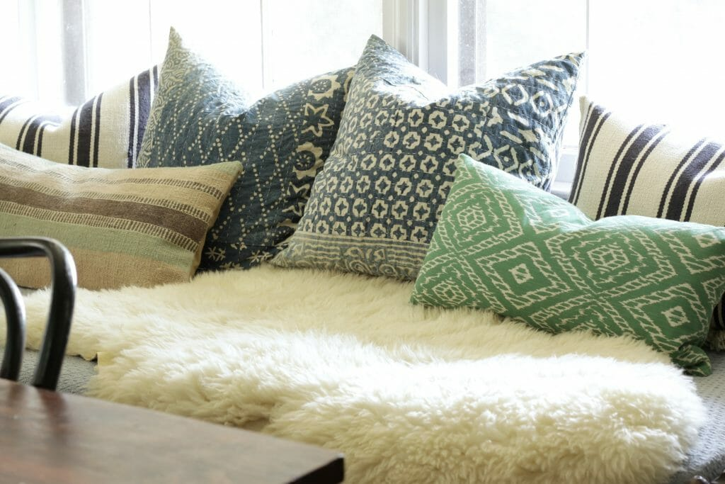 cozy-pillows-and-sheepskin-daybed