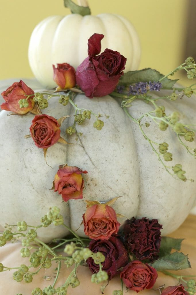 cascading dried flowers on pumpkin display