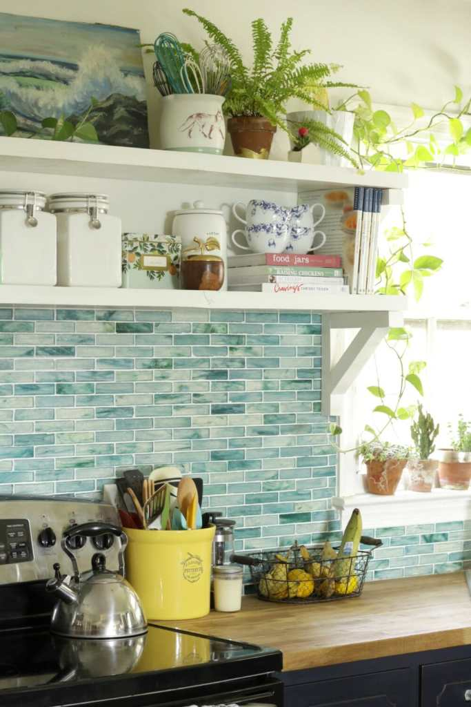 open-shelving-fall-styling-plants-aqua-backsplash