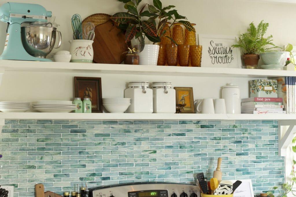 Open Shelving with Aqua Recycled Glass Backsplash
