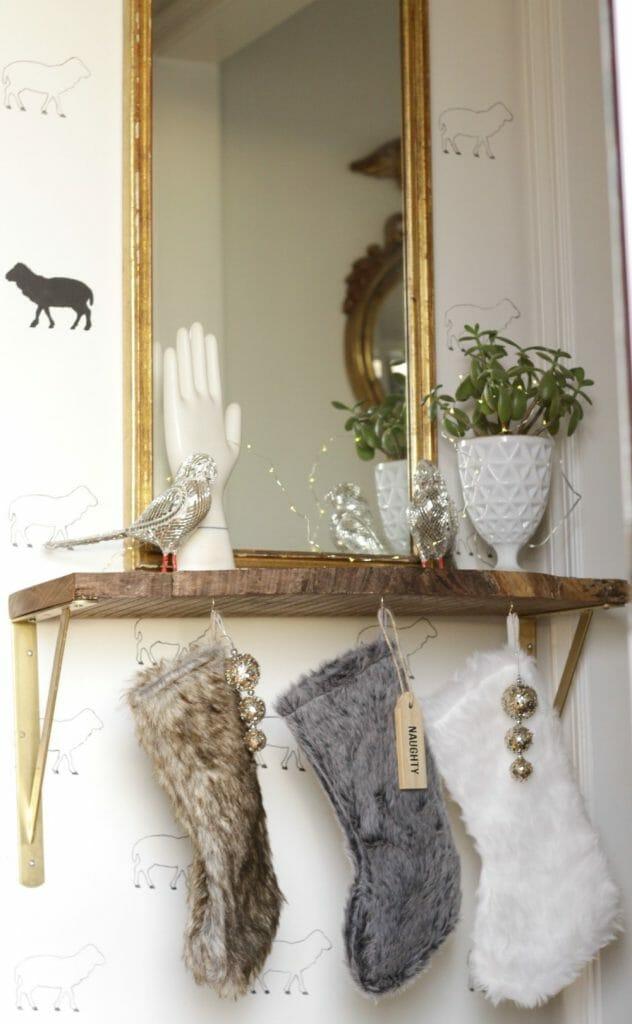 Teacup hooks hang fur stockings