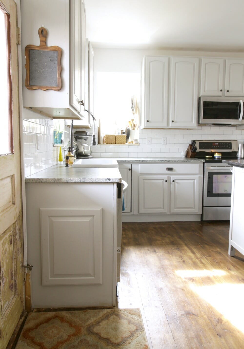 Fancy Gray Farmhouse Kitchen with Original Doors