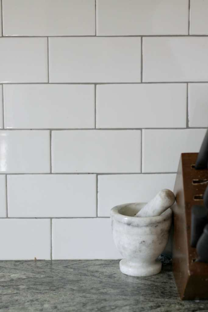 White Subway tile with gray grout backsplash