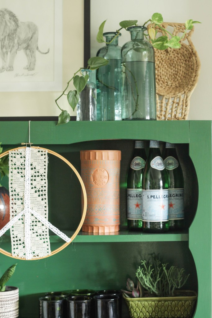 DIY Embroidery Hoop Peace Sign on hutch
