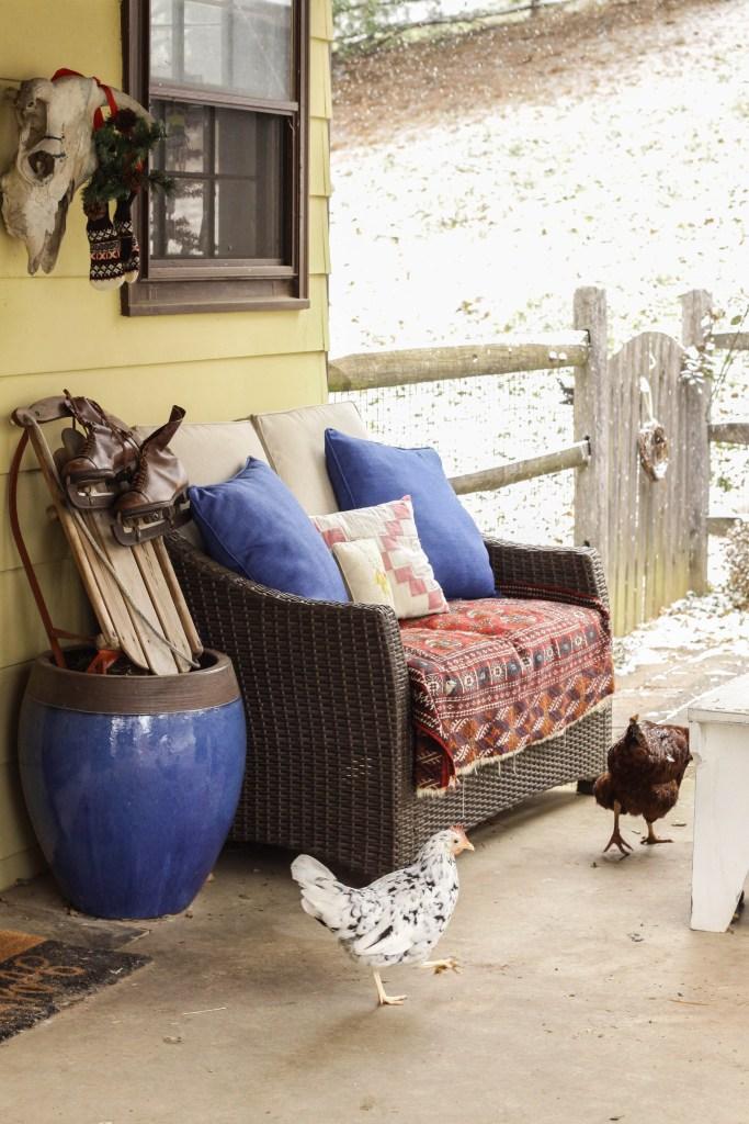 Wicker Loveseat with vintage persian rug