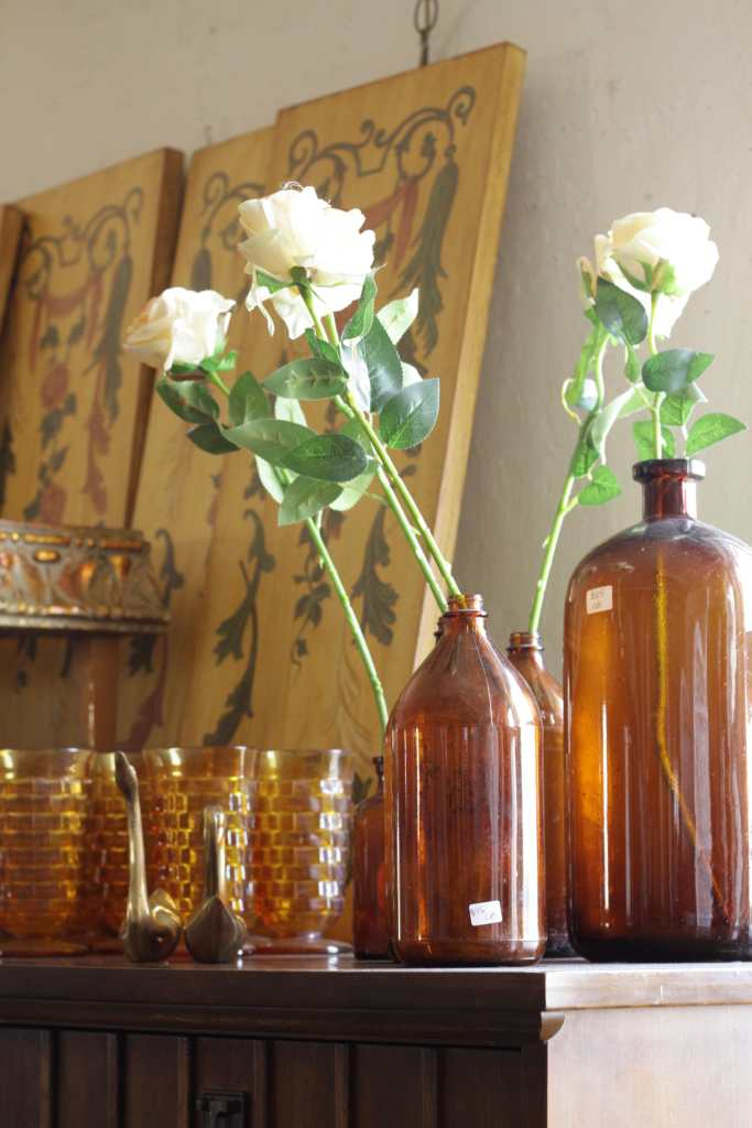 Amber bottles as vases