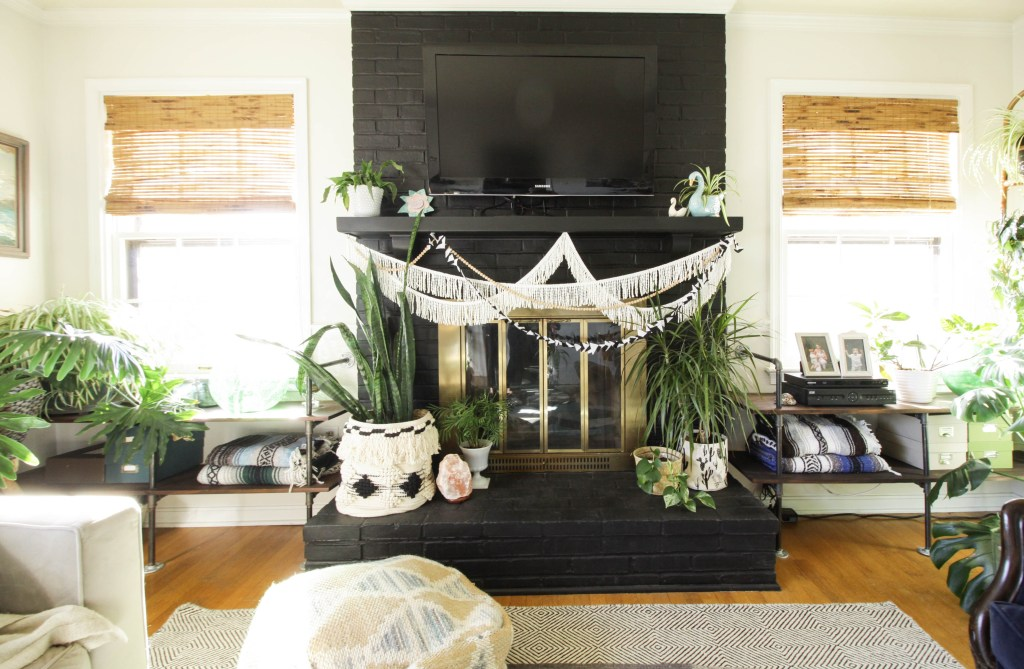 Black painted fireplace with DIY built ins