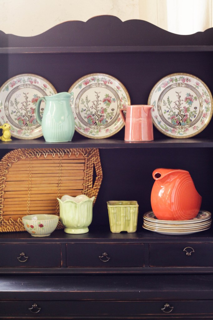 Colorful dishes on black hutch