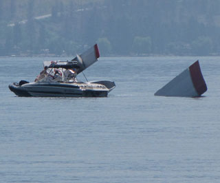 Boaters were able to get to the pilot of the water plane after he crashed into the lake. (Photo: Contributed)