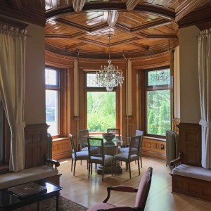 Stunning woodwork complement leaded glass windows in the Parapet of the Parlor at Castle La Crosse Bed and Breakfast