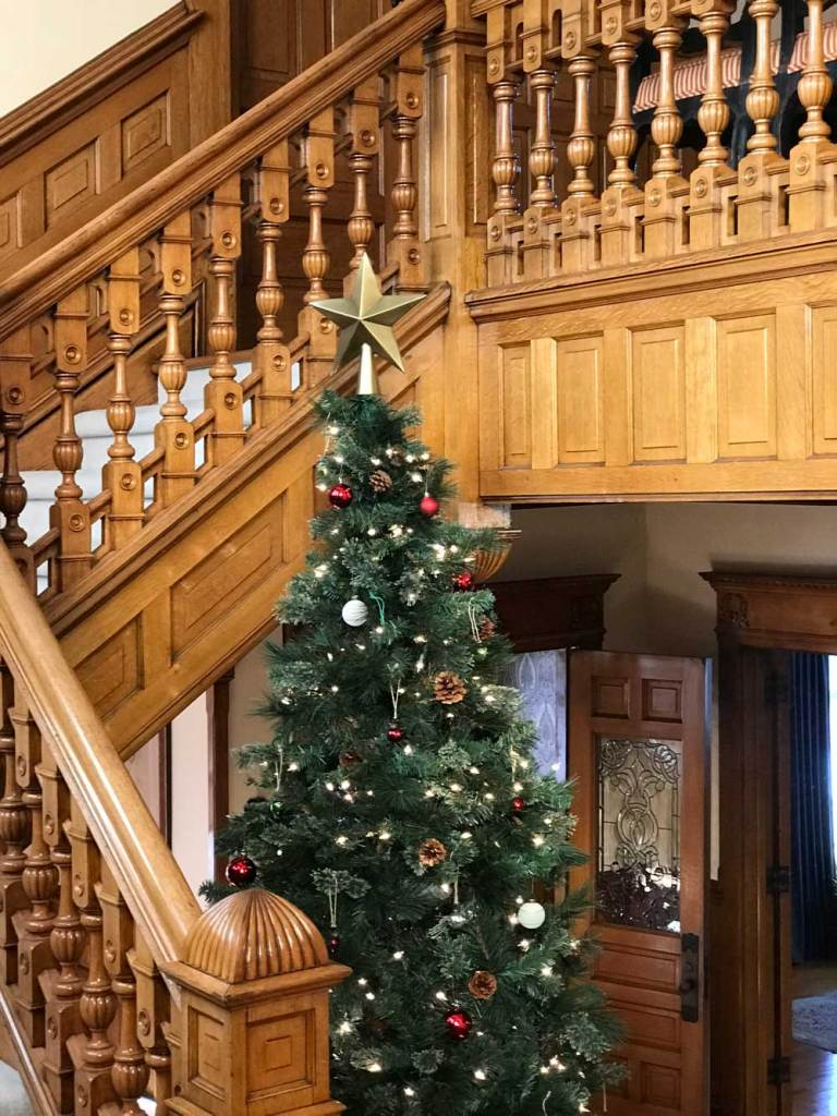 Staircase Wrapped Around Christmas Tree at Castle La Crosse