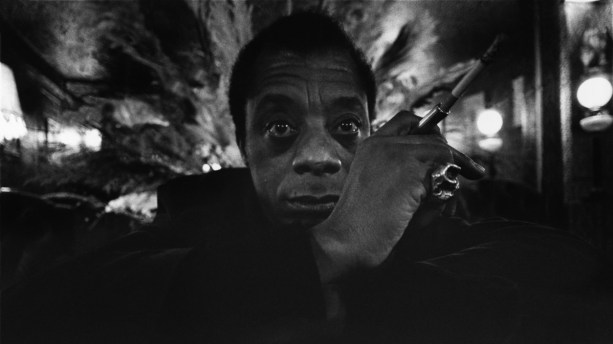 The American author James BALDWIN posing in the lobby of his hotel the Relais Bisson in Paris. Ara Güler / Magnum Photos