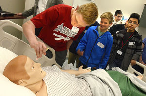 ROBERT C. REED/RECORD: Eighth-grader Matthew Hancock (center) from Arndt Middle School uses a penlight to check the response of a simulation patient during a Catawba Valley Community College Science, Technology, Engineering and Math (STEM) tour.