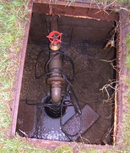Poorly protected wellhead that would be vulnerable to flooding
