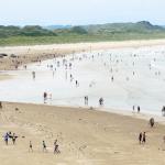 FIGURE 1: BATHERS ON ENNISCRONE BEACH