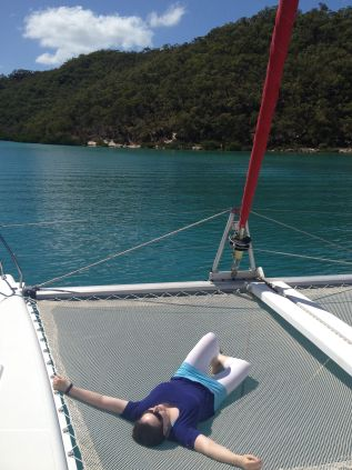 Me, lying on a boat in the Whitsundays