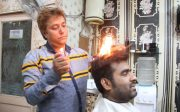 indian barber sets hair fire