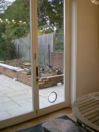 CAT FLAP FITTER- into glass, through walls, doors, UPVC ...